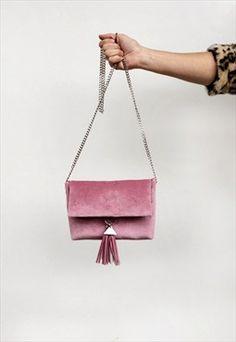 Cute pink velvet handbag with tassel.