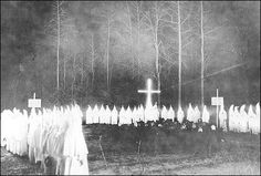 An extremely rare view of a Ku Klux Klan meeting at night in Union County, Arkansas in the 1920s.