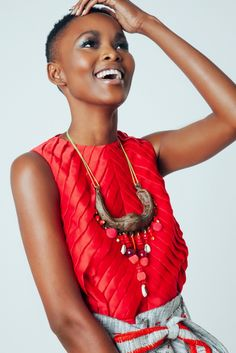 Flaviana Matata so beautiful with sleeveless red top and big necklace
