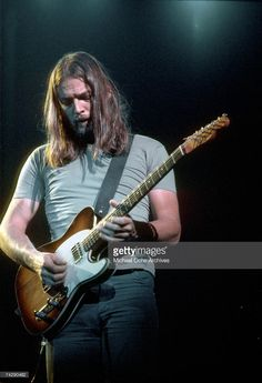 Dave Gilmour of Pink Floyd on stage at the Sports Arena in April 1975 in Los ...