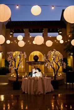Sweetheart Table After Sunset    Photography: This Modern Romance   Read More:  http://www.insideweddings.com/weddings/modern-wedding-at-a-spanish-courtyard-in-southern-california/780/