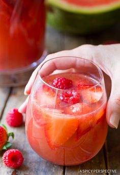Blushing Rose Sangria Recipe loaded with all things pink: strawberries, raspberries, and watermelon. Perfect for Mother's Day, or spring and summer parties.