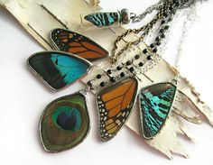 Encased butterfly necklaces by Crystal Popko. Featured in Where Magazine and The Boston Globe.