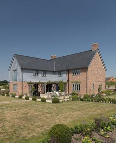 Replacing a large, ramshackled collection of old brick buildings has resulted in a truly beautiful new Border Oak home in a secluded location House Cladding, Exterior Cladding, House Extension Design, House Design, Extension Ideas, Metal Building Homes, Building A House, Modern Farmhouse Exterior, Farmhouse Interior