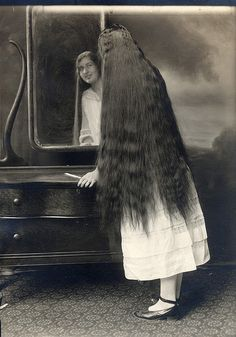 Edwardian Era hair.  Wish I could grow it like this!  It's all crimped and brushed, too.  Betcha she hasn't ant snarls & tangles, either.