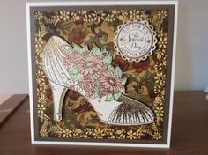 Card decorated with a die cut and stamp from heartfelt creations all glammed up collection.