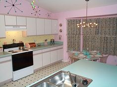 Kitchen - The builder actually offered these turquoise countertops. Pre New Flooring & Retro Oven/Stove.