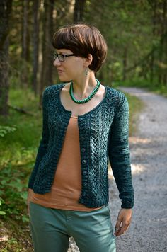 Honeybee Cardigan by Laura Chau ~                   a lacey 4 ply cardigan ~ Knit from the bottom up with a 4ply fingering weight yarn.  Sized: 28 (33, 34.5, 38){42.5, 45, 50, 56}