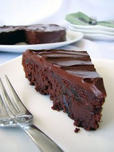 "Should be easy to veganize for the Scottish Hogmaney this week -- Dorie Greenspan's Chocolate Armagnac Cake (aka ""The Cake that Got Me Fired""). This is my Big Event go-to cake. Rich– tiny slice rich– dense, fudgy, boozy cake. Cut the fruit really small and it melts right in."