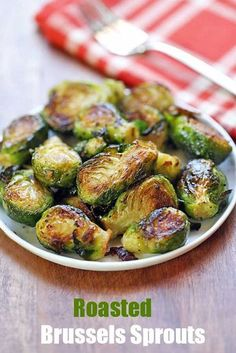 An easy recipe for oven roasted Brussels sprouts, seasoned with butter, garlic and Parmesan.
