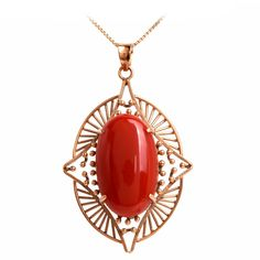 Retro Natural Red Coral Gold Pendant | From a unique collection of vintage drop necklaces at https://www.1stdibs.com/jewelry/necklaces/drop-necklaces/