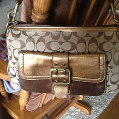 Coach signature brown and gold bag, fall 2004 Really nice authentic Coach bag. Can be a shoulder bag or arm bag. In excellent condition. Fall 2004 Special Edition stamped on Coach tag. Fabric, leather and suede! 8inches high, 11.5 across, 3 inches across bottom. Coach Bags Shoulder Bags