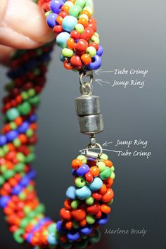 Marlene Brady. As seen on the web, by sliding a short crimp tube on a jump ring and securing my beading thread through the crimp tube, it provides a nice neat and strong finish. Bracelet-Russian Spiral.