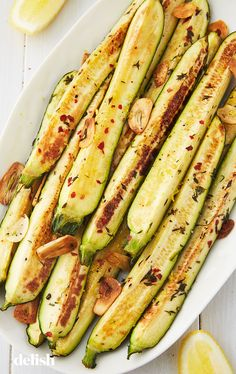 The perfect low-key side dish. Get the recipe from Delish.com. #zucchini #veggies #baked #recipe #sides #oven #healthy #easy
