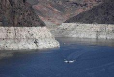 Water level in reservoir formed by Hoover Dam dips to record low
