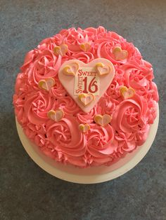 Sweet 16 pink rosette vanilla strawberry cake with handmade fondant heart toppers painted with gold accents. By Natalie Baxter
