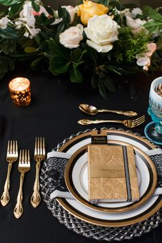 gold and black reception table - photo by Boyfriend Girlfriend http://ruffledblog.com/elegant-toronto-wedding-inspired-by-dolce-and-gabbana #weddingideas #tablesetting