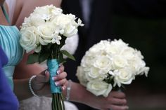 White wedding bouquets, complete with Tiffany blue ribbons and rhinestones