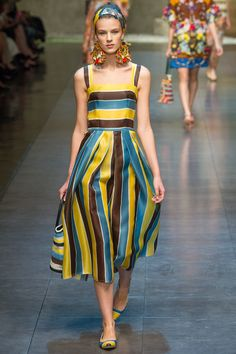 Dolce and Gabbana. Spring 2013 Ready to Wear. The entire collection is reminiscent of gypsy fashion, rustic Italian villages, and Mediterranean summers. I love this striped Boho-style summer dress.