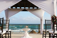 The pergola at @nowresorts Now Jade resort with a pretty wedding ceremony set-up, great view of the Mexican Caribbean Sea! Mexico wedding photographers Del Sol Photography. #gazebowedding #beachgazebo #nowhotels