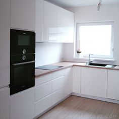 White kitchen with wooden countertop and black household appliances .- Biała kuchnia z drewnianym blatem i czarnymi sprzętami A… in 2020 Kitchen Room Design, Luxury Kitchen Design, Home Decor Kitchen, Interior Design Kitchen, Home Kitchens, Kitchen Dining Living, Diy Kitchen Remodel, Cuisines Design, Feng Shui