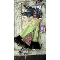 Mixed media Halloween witch paper doll assemblage, OOAK, crepe paper... ❤ liked on Polyvore featuring home, home decor, holiday decorations, vintage holiday decor, witch ornaments, glitter ornaments, holiday window decorations and vintage home decor