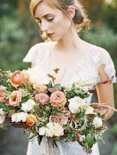 Moss Mountain Farms Wedding in Arkansas | We wanted everything from the groom's boutonnière to the cuisine to express the rich heritage and organic nature of the farm. You'll see ideas for an Organic Bouquet, lush bouquet, wedding ceremony, wedding flowers, floral arrangement and flower crowns | #wedding #weddingflorals #floral #bride #lacedress #weddings #weddingdress #weddingceremony