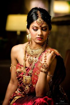 Sexy South Indian Bride Hair and Makeup Shoot by MG Beauty Enhancement with long gold necklaces #indianjewelry #indianwedding