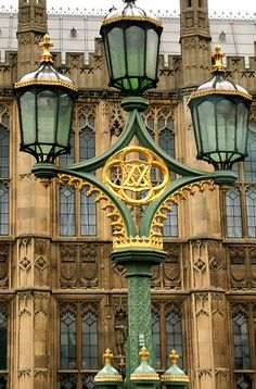 The 'V' and 'A' for Victoria and Albert are intertwined on the street lamps in London outside the Houses of Parliament.