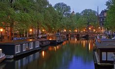 7-day tour of Amsterdam, Bruges, and Paris with hotel accommodations; includes a boat cruise on the canal and tours of medieval cities