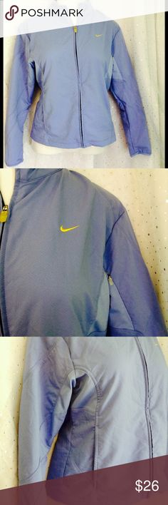 Nike Sphere Dry Jacket Large (12/14) Perfect for working out or running errands, this lightweight jacket is stylish as well.  Mesh lined to keep you cool.  Exterior side pockets and sleeve cell zipper pocket and interior side pockets.  Zipper works great!  Excellent pre loved condition.  Measurements taken lying flat, straight across, in inches.  Length: 24, Sleeve to shoulder: 23, Collar to Shoulder: 5.5 Poly/spandex blend. Nike Jackets & Coats