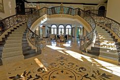 Very grand!    French style custom estate featured on HGTV traditional staircase