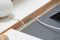 StudioDesk's elongated slot across the top of the desk allows for peripheral connectors to come out while hiding the mess down below.