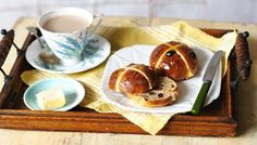 The classic hot cross bun recipe: easy to make, packed with flavour and irresistible slathered with butter. #PaulHollywood