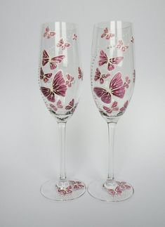Hand painted Wedding Toasting Flutes Set of 2 Personalized Champagne glasses White and purple Butterflies love flight Wedding Toasting Glasses, Wedding Champagne Flutes, Toasting Flutes, Champagne Glasses, Painting Glass Jars, Glass Painting Designs, Glass Etching, Decorated Wine Glasses, Hand Painted Wine Glasses