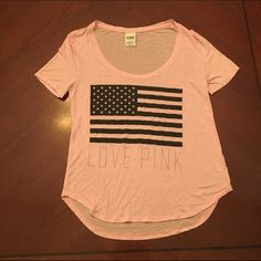 Victoria's Secret American Flag T-shirt Worn once or twice. Light pink with black and white American flag. Size small.   ✨ Always open to reasonable offers and negotiations! Please use offer button. No trades. ✨ PINK Victoria's Secret Tops Tees - Short Sleeve