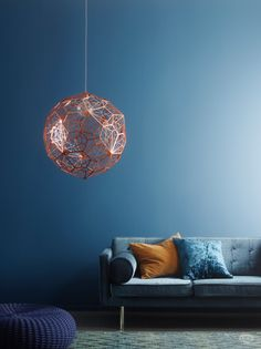 We like moody blues for the colder months (and that Tom Dixon pendant warms us up nicely, too!).