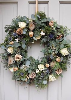 christmas wreaths My Christmas wreath for 2016 using pine, eucalyptus, foraged berries, poppy seed heads, roses and bleached pine cones. Made on a floral foam base. Blue Christmas Decor, Christmas Door Wreaths, Christmas Flowers, Holiday Wreaths, Christmas Crafts, Christmas Decorations, Handmade Wreaths Christmas, Winter Wreaths, Winter Christmas