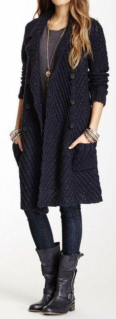 Shop this look on Lookastic:  http://lookastic.com/women/looks/knee-high-boots-skinny-jeans-bracelet-cardigan-crew-neck-t-shirt-pendant/5337  — Black Leather Knee High Boots  — Black Skinny Jeans  — Gold Bracelet  — Navy Knit Cardigan  — Charcoal Crew-neck T-shirt  — Gold Pendant