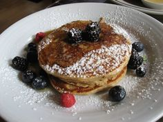 whole wheat pancakes with fresh berries and maple syrup Whole Wheat Pancakes, Little Owl, Maple Syrup, Berries, Nyc, Fresh, Breakfast, Food, Morning Coffee