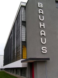 "Walter Gropius. Dessau Bauhaus Building. 1926. Gropius is the founder of the school. The principle of Bauhaus design is ""form follows function."" Think of the purpose first, then build around it. Simplicity of design is also important. One of the greatest developments is the use of reinforced steel walls, which allow heavy, load-bearing walls to come down. In turn, this allows windows (even on corners), which diminishes the separation between the external and internal."