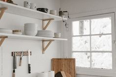 corner of modern white kitchen by Nicole Mason for Stocksy United