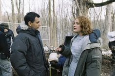 M. Night Shyamalan and Bryce Dallas Howard on the set of The Village (2004).