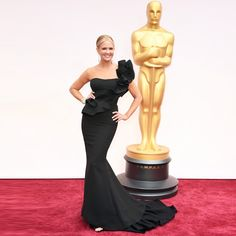 Nancy O'Dell looked chic in a black Gauri and Nainika gown at the Oscars.