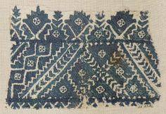 Embroidery fragment      Moroccan, 18th century   Dimensions      Overall: 14.5 x 21.5 cm (5 11/16 x 8 7/16 in.)  Medium or Technique      Cotton and silk; embroidery  Classification      Textiles   Accession Number      22.222