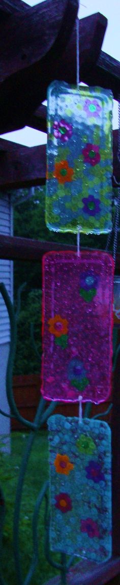 Fun Suncatchers all you need is pony beads oven 400* 20min. in a baking pan of choice cool and pop out. drill for hole string and a little imagination! cf