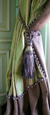 .Maybe I should make curtains that have different colors, like green on one side and lilac on the other.