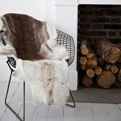 Bertoia chair hide fur white wood floor fireplace