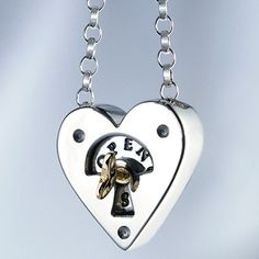 """Description: The gold key to your heart will rotate to reveal 'open""""closed' Size: 2cm (w) x 2cm (h) Materials: Silver, Gold"""