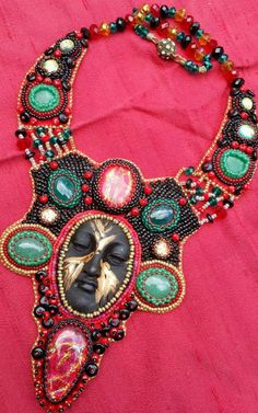 Necklace by Niki Myers Rogerson - ceramic face by Diane Briegleb Bead Embroidery Jewelry, Beaded Embroidery, Face Jewellery, Beaded Jewelry Designs, Beading Projects, Metal Clay, Leather Necklace, Clay Creations, Art Dolls
